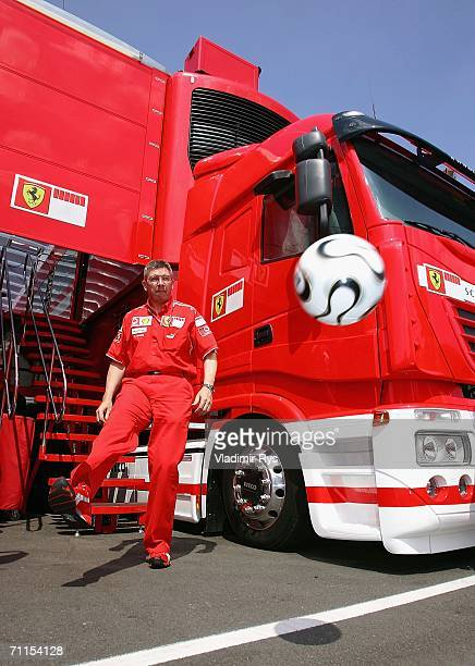 Ferrari F1 Technical director Ross Brawn kicks an official 'Teamgeist' ball in the paddock during the preparations for the Formula One British Grand...