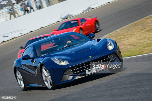 ferrari f12 berlinetta gran turismo sports car - v12 stock photos and pictures