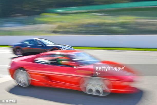 Ferrari F355 and Maserati Quattroporte at high speed