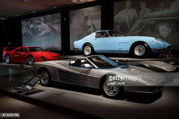 A Ferrari F40 1987 a Ferrari Testarossa Spyder 1986 and a Ferrari 275 GTB/4 1967 on display at the 'Ferrari Under the Skin' exhibition at the Design...