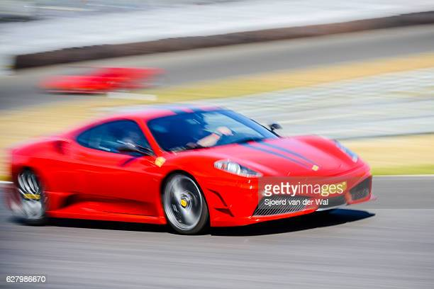 ferrari f430 scuderia italian v8 sports car driving fast - ferrari stock pictures, royalty-free photos & images