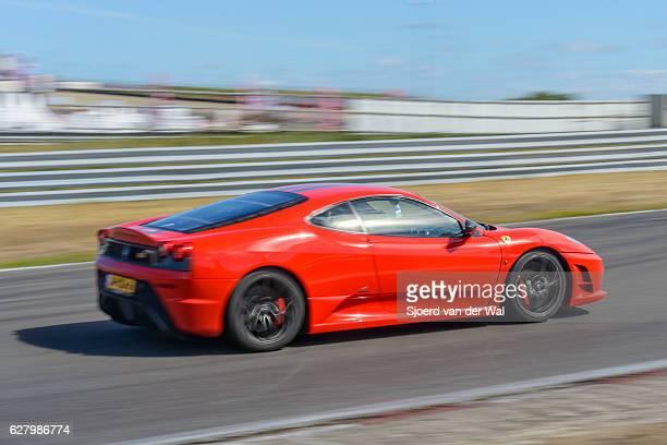 """ferrari f430 scuderia italian v8 sports car driving fast - """"sjoerd van der wal"""" fotografías e imágenes de stock"""