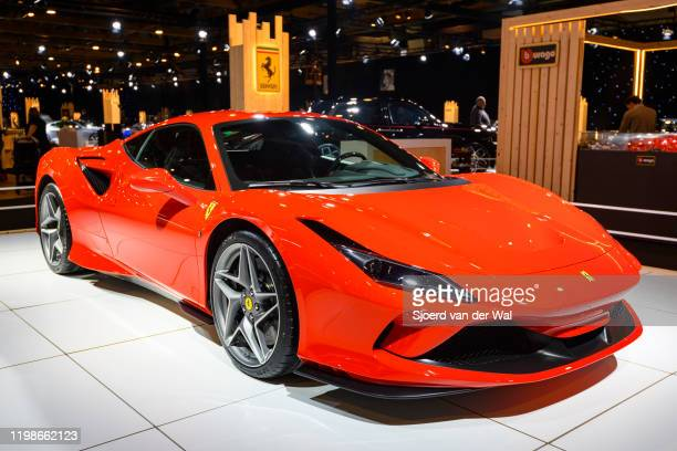 Ferrari F8 Tributo Italian mid-engine sports car in red on display at Brussels Expo on JANUARY 08, 2020 in Brussels, Belgium. The F8 Tributo uses a...