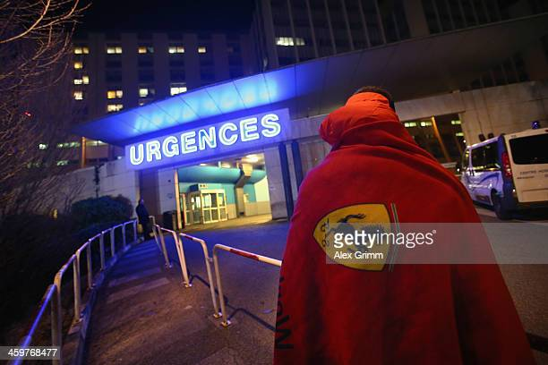 Ferrari fan waits in front of the emergency hospitalisation of Grenoble Hospital where former German Formula One driver Michael Schumacher is being...