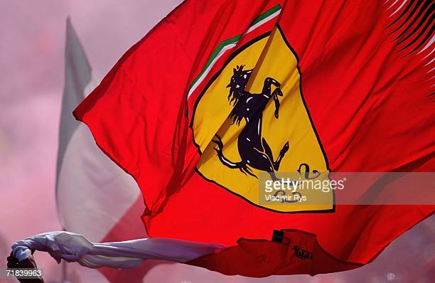 Ferrari fan waves the flag after the end of the Italian Formula One Grand Prix at Autodromo Nazionale Monza on September 10 2006 in Monza Italy