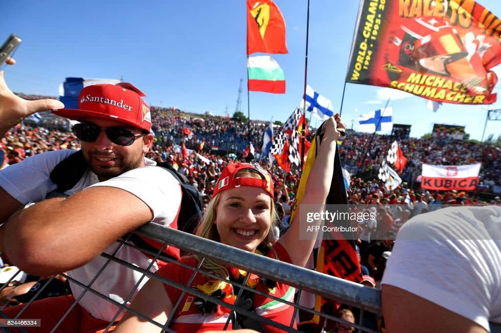 Ferrari fans celebrate after the Formula One Hungarian Grand Prix at the Hungaroring racing circuit in Budapest on July 30, 2017. /
