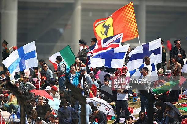 Ferrari fans cheer on their drivers during the Formula One Grand Prix of China at Shanghai International Circuit on April 12 2015 in Shanghai China
