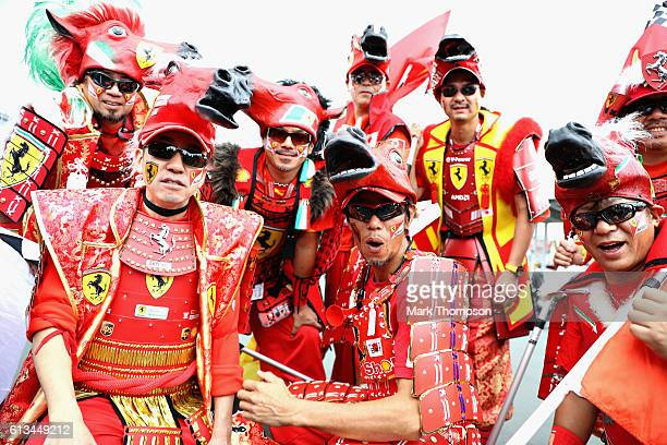 Ferrari fans dressed as Samurai in the fan zone before the Formula One Grand Prix of Japan at Suzuka Circuit on October 9 2016 in Suzuka