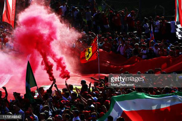 Ferrari fans enjoy the atmosphere at the podium during the F1 Grand Prix of Italy at Autodromo di Monza on September 08, 2019 in Monza, Italy.