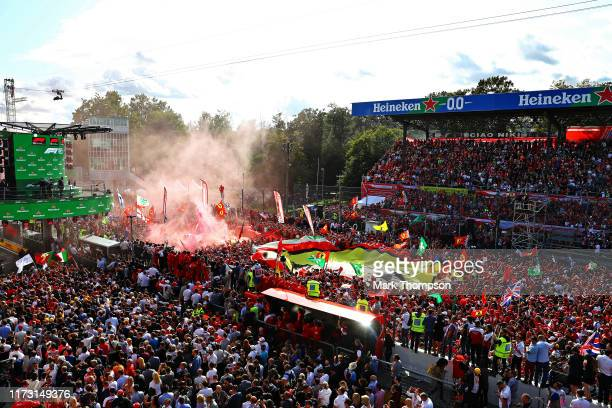 Ferrari fans enjoy the atmosphere at the podium during the F1 Grand Prix of Italy at Autodromo di Monza on September 08 2019 in Monza Italy