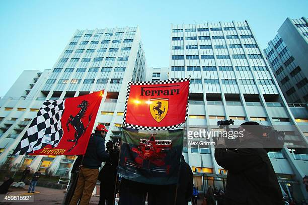 Ferrari fans set up flags outside the Grenoble University Hospital Centre where former German Formula One driver Michael Schumacher is being treated...