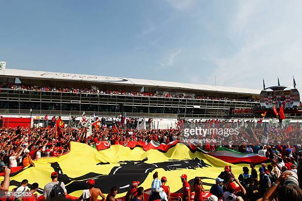 Ferrari fans unfurl a giant Prancing Horse flag on the track during the podium celebrations following the Italian Formula One Grand Prix at the...