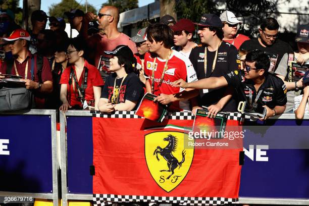 Ferrari fans wait for the drivers to arrive before practice for the Australian Formula One Grand Prix at Albert Park on March 23 2018 in Melbourne...