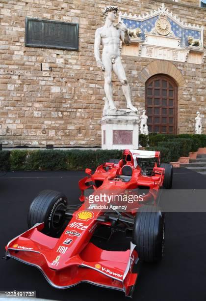 Ferrari formula car model is exhibited during an event to celebrate the Ferrariâs 1000th Formula 1 Grand Prix at Piazza Della Signoria in Florence,...