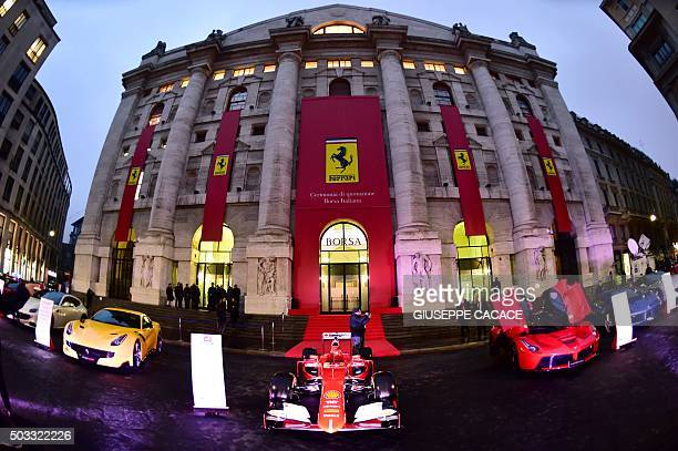 A Ferrari Formula One car is displayed along with other cars from the iconic Italian car makers outside the stock exchange in Milan on January 4 2016...