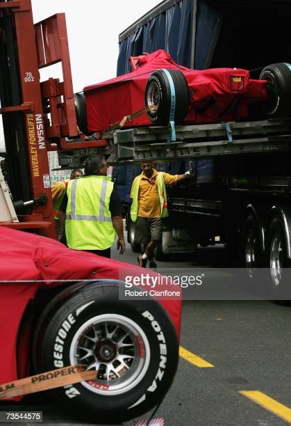 Ferrari formula one cars are delivered to the Albert Park pit lane ahead of the Australian Formula One Grand Prix at the Albert Park Circuit on March...