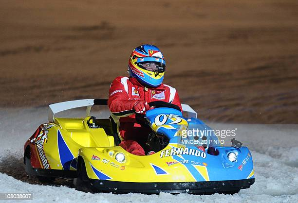 Ferrari Formula One driver Spanish Fernando Alonso takes part in an ice kart race on January 14 during the 'Vroom 2011 F1 and MotoGP Press Ski...