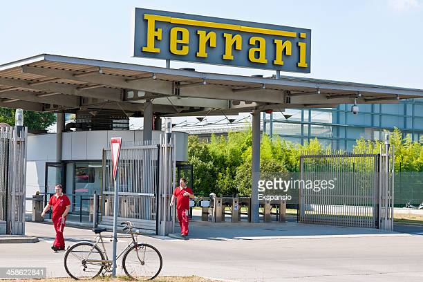ferrari formula one racing car workers at main factory entrance - maranello stock pictures, royalty-free photos & images