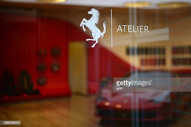 A Ferrari is displayed in the 'tailormade' department of the Ferrari factory where the handfinished road vehicles are being produced on December 5...