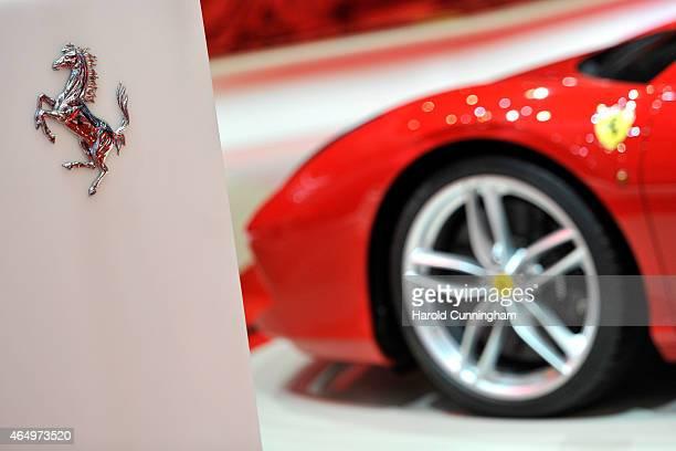 Ferrari logo is displayed at the Geneva International Motor Show on March 2, 2015 in Geneva, Switzerland. The 85th International Motor Show held from...