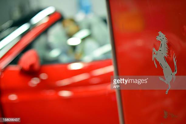 A Ferrari logo is displayed in the Ferrari factory where the handfinished road vehicles are being produced on December 5 2012 in Maranello The...