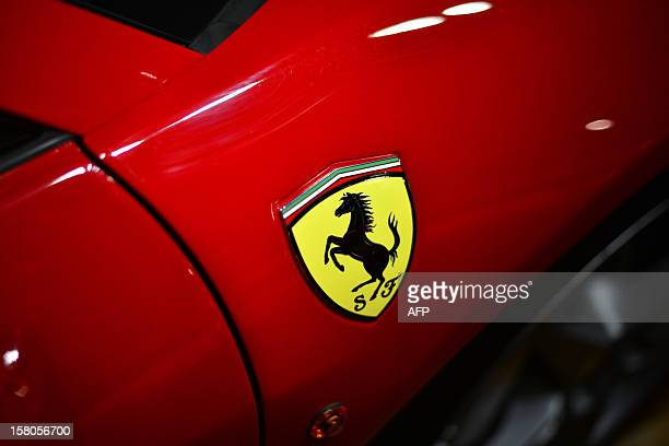 A Ferrari logo is displayed on a car in the 'tailormade' department of the Ferrari factory where the handfinished road vehicles are being produced on...