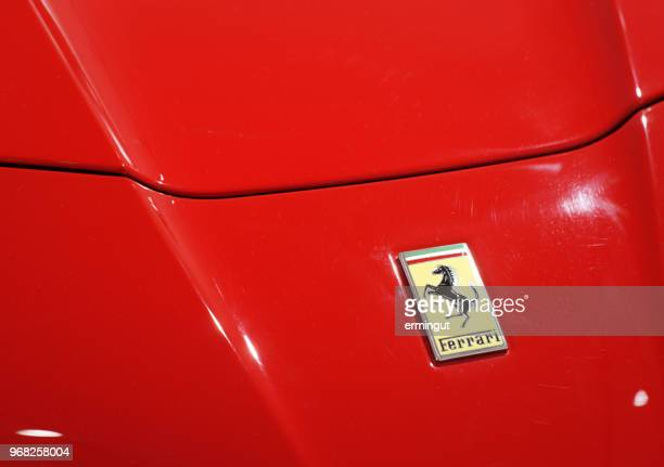ferrari logo on red car bonnet. - ferrari stock pictures, royalty-free photos & images