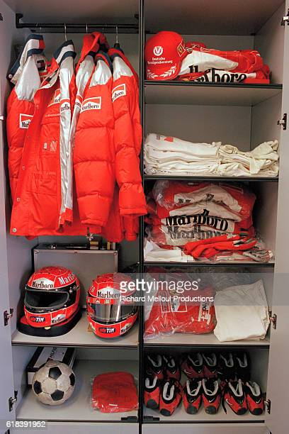 Ferrari Managing Director Jean Todt gives a guided tour behind the scenes at the Ferrari production factory Race clothing belonging to Formula One...