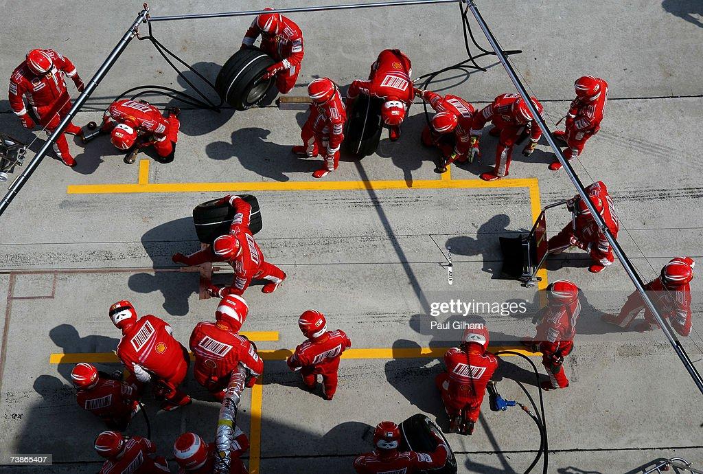 Ferrari mechanics wait for Kimi Raikkonen of Finland and Ferrari to make a pitstop during the Malaysian Formula One Grand Prix at the Sepang Circuit on April 8, 2007, in Kuala Lumpur, Malaysia.