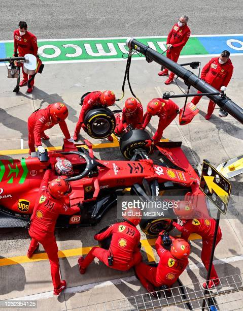 Ferrari mechanics work on the car of Ferrari's Monegasque driver Charles Leclerc in the pit lane during a practice session at the Autodromo...