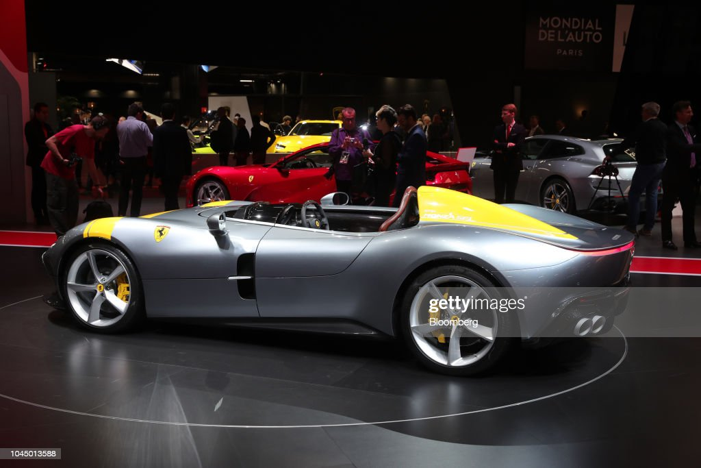 A Ferrari Monza SP Luxury Automobile Stands On Display At The Paris - Car show wheel display stands