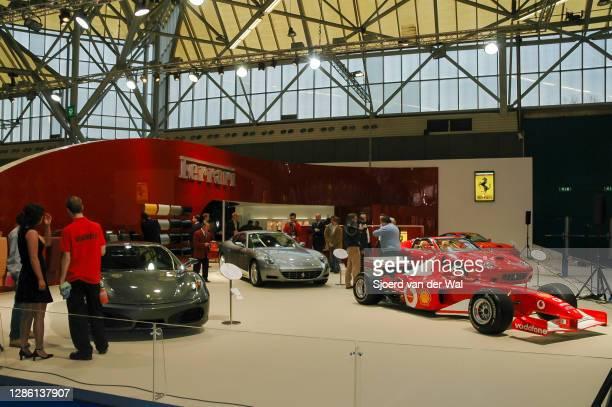 Ferrari motor show stand with the Ferrar F2004 F1 car, F430 sports car and 612 Scaglietti GT luxury car on display at Amsterdam motor show AutoRAI on...