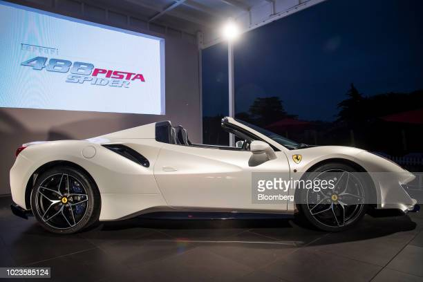 Ferrari NV 488 Pista Spider vehicle sits on display during the company's unveiling event at the 2018 Pebble Beach Concours d'Elegance in Pebble...