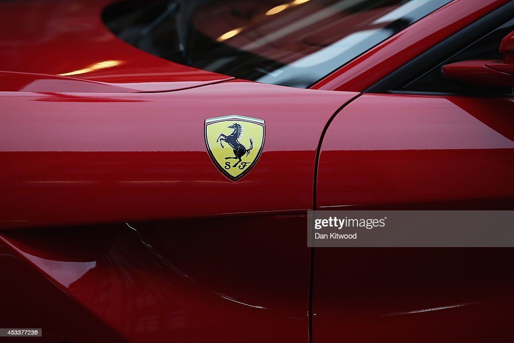 A Ferrari parks in Knightsbridge on August 8, 2014 in London, England. Tourists and car enthusiasts have been flocking to the wealthy London district to see some of the world's most expensive and extravagant super cars. Many of the rich owners from Saudi Arabia and Kuwait come to London to escape the summer heat at home and to show off their cars before moving on to other European cities such as Paris and Cannes.