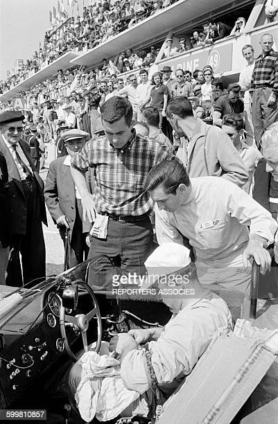 Ferrari Pilots Roger Penske with checked shirt and Pedro Rodriguez Looking at the Mechanic Seated in the Car at the Auto Race the 24 Hours of Le Mans...