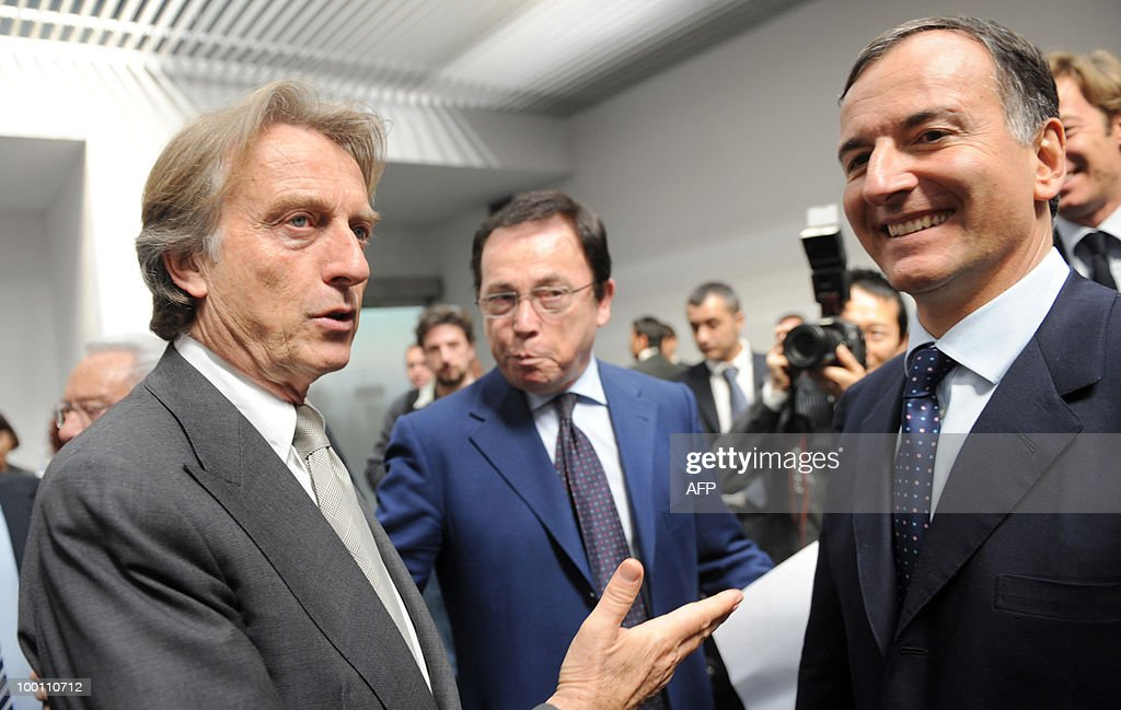 Ferrari President Luca Cordero di Montezemolo and Italian Foreign Minister Franco Frattini (R) talk before a conference as part of the 80th anniversary of the Italian car maker Pininfarina group in Cambiano near Turin on May 21, 2010.