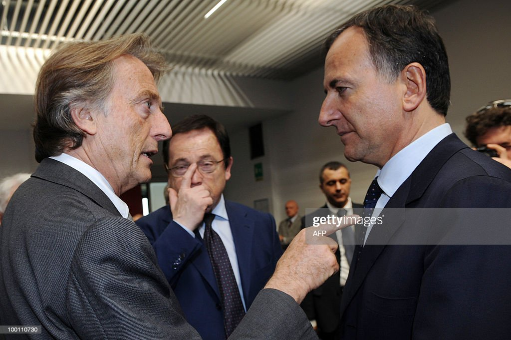 Ferrari President Luca Cordero di Montezemolo and Italian Foreign Minister Franco Frattini (R) talk before a conference as part of the 80th anniversary of Pininfarina group in Cambiano near Turin on May 21, 2010.
