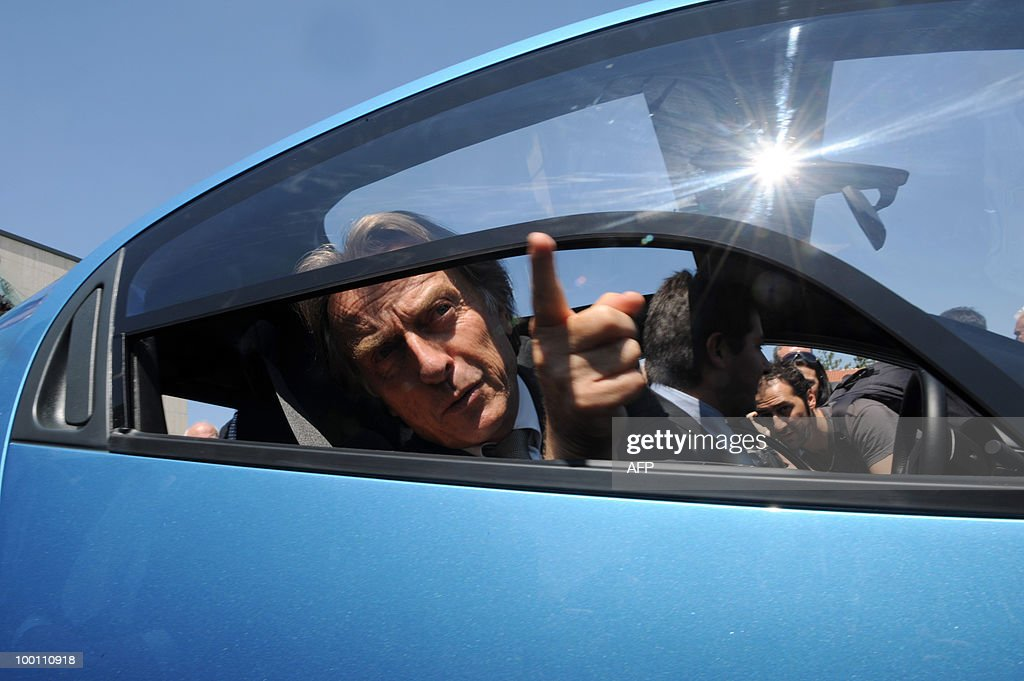 Ferrari President Luca Cordero di Montezemolo gestures from inside the new Pininfarina electric car 'Nido' during the 80th anniversary celebrations of Pininfarina group in Cambiano near Turin on May 21, 2010.
