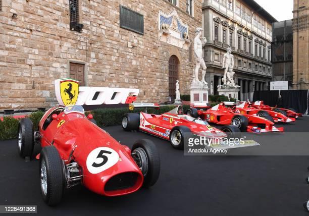 Ferrari Racing car models are exhibited during an event to celebrate the Ferrariâs 1000th Formula 1 Grand Prix at Piazza Della Signoria in Florence,...