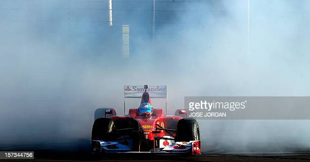 Ferrari Spanish driver Fernando Alonso drives during the Ferrari World Finals at Ricardo Tormo racetrack in Cheste, on December 02, 2012. AFP PHOTO /...