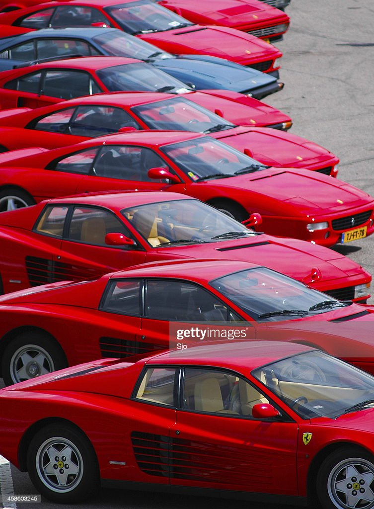 Ferrari Sports Cars Line Up With Red Testarossa And F355 : Stock Photo