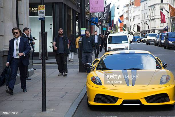 Ferrari supercar parked on Old Bond Street in Mayfair In a selected few boroughs of West London wealth has changed over the last couple of decades...
