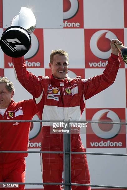 Ferrari team manager Jean Todt left and winner Michael Schumacher celebrate their victory on the podium at the Formula 1 GP of Italy in Monza Italy...