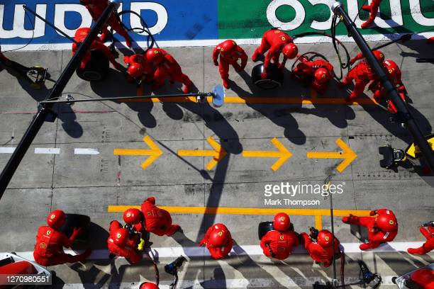 Ferrari team members prepare for a pit stop during the F1 Grand Prix of Italy at Autodromo di Monza on September 06, 2020 in Monza, Italy.
