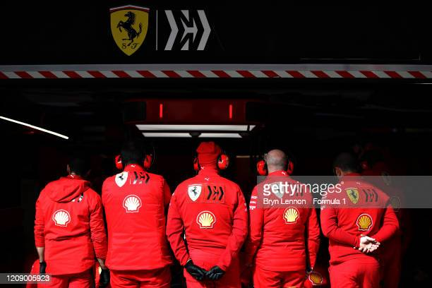 Ferrari team members stand at the front of the garage during Day Two of F1 Winter Testing at Circuit de Barcelona-Catalunya on February 27, 2020 in...