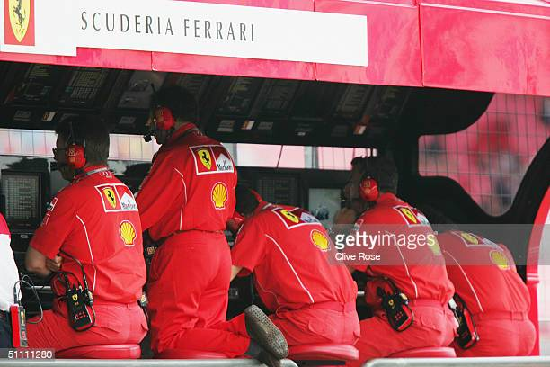 Ferrari team Personel on the pitwall during the practice session prior to qualifying for the German F1 Grand Prix at the Hockenheim Circuit on July...