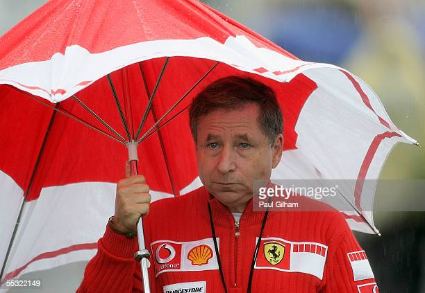 Ferrari team principal Jean Todt takes cover from the rain during the practice session for the Belgium F1 Grand Prix at the Circuit of Spa...