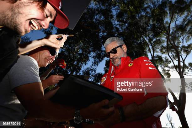 Ferrari Team Principal Maurizio Arrivabene arrives at the circuit and signs autographs for fans before practice for the Australian Formula One Grand...