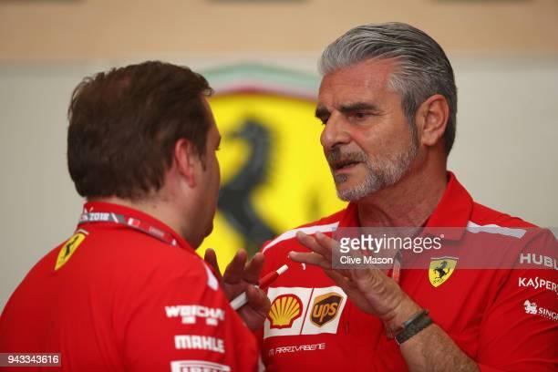 Ferrari Team Principal Maurizio Arrivabene talks with Ferrari engineer Dave Greenwood in the Paddock before the Bahrain Formula One Grand Prix at...