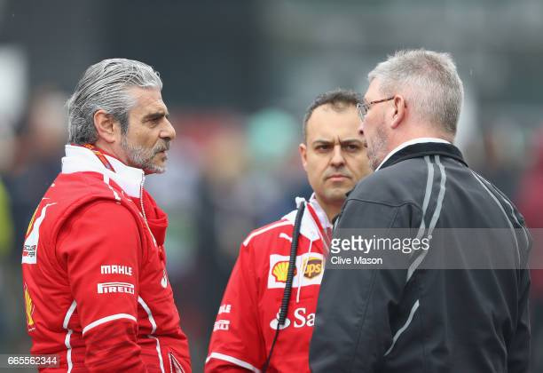 Ferrari Team Principal Maurizio Arrivabene talks with Ross Brawn Managing Director of the Formula One Group in the Paddock after Free Practice 2 was...